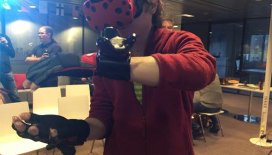 A player wears the Hi5 virtual reality glove by Noitom at TechCode in Finland..