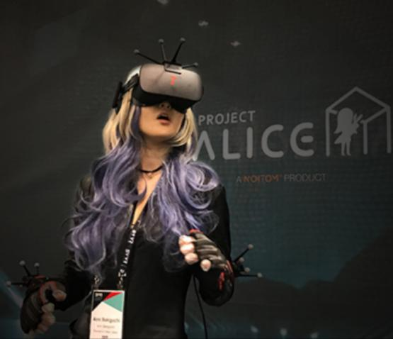 A Japanese influencer wears goggles at the Alice Space virtual reality experience by Noitom at SVVR 2017.